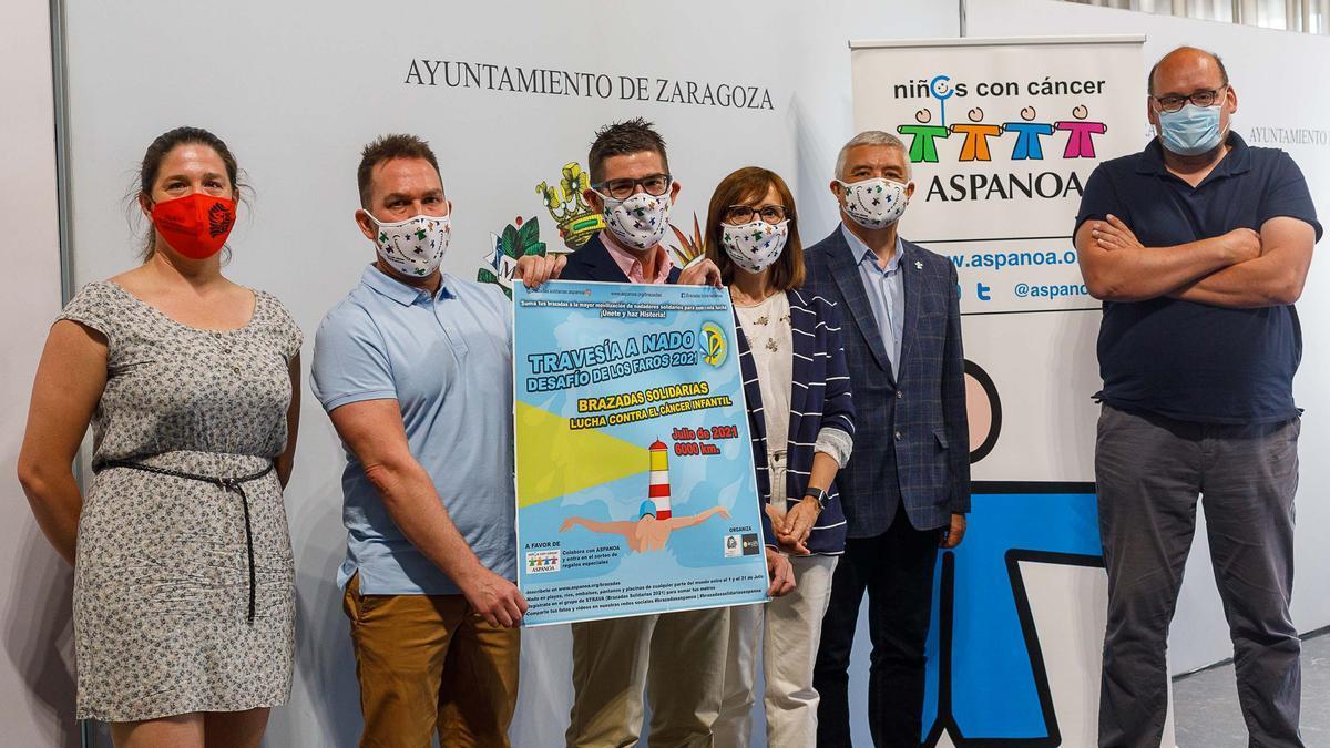 Presentación del cartel de la iniciativa en el Ayuntamiento de Zaragoza.