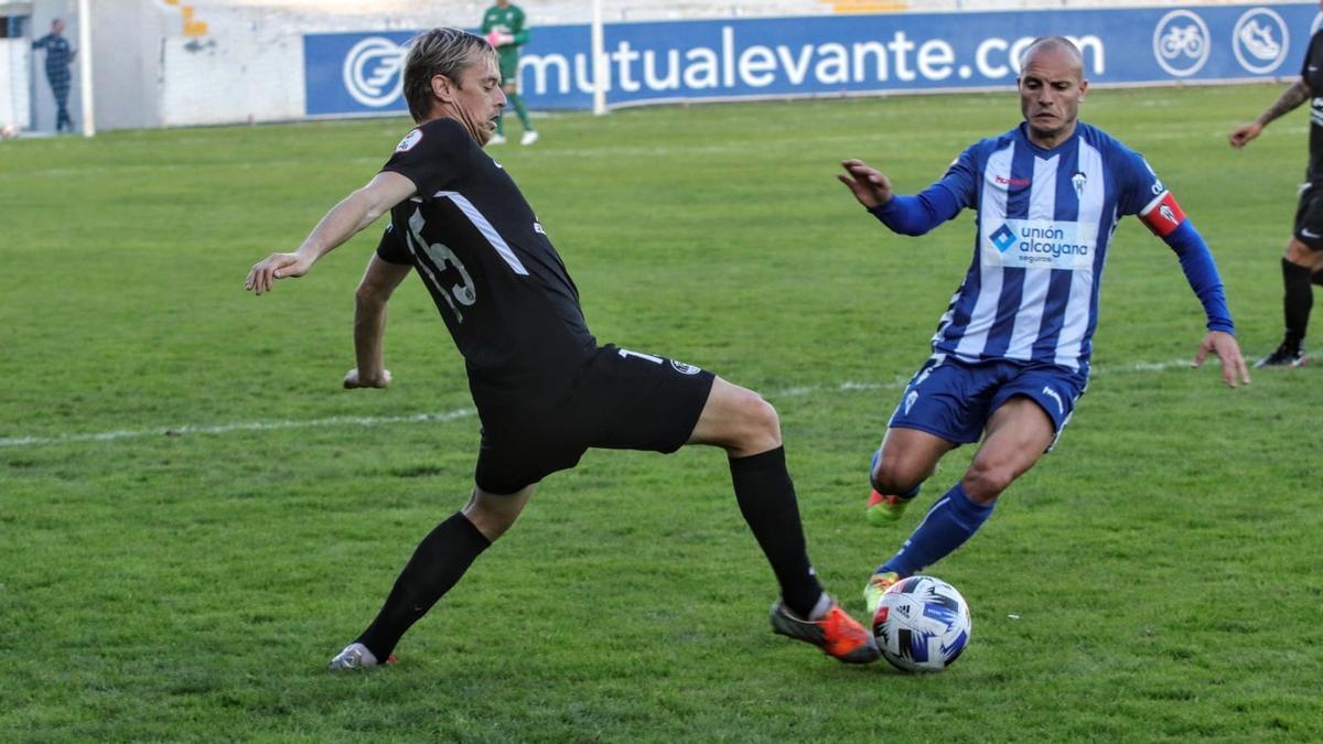 Javi Lara y Juli durante el partido en El Collao.
