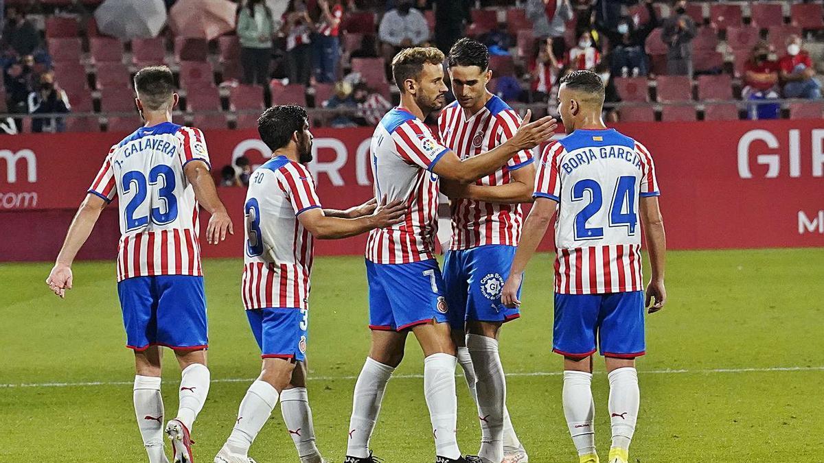 Els jugadors del Girona celebren el gol d'Stuani contra el Valladolid de diumenge passat.  | MARC MARTÍ