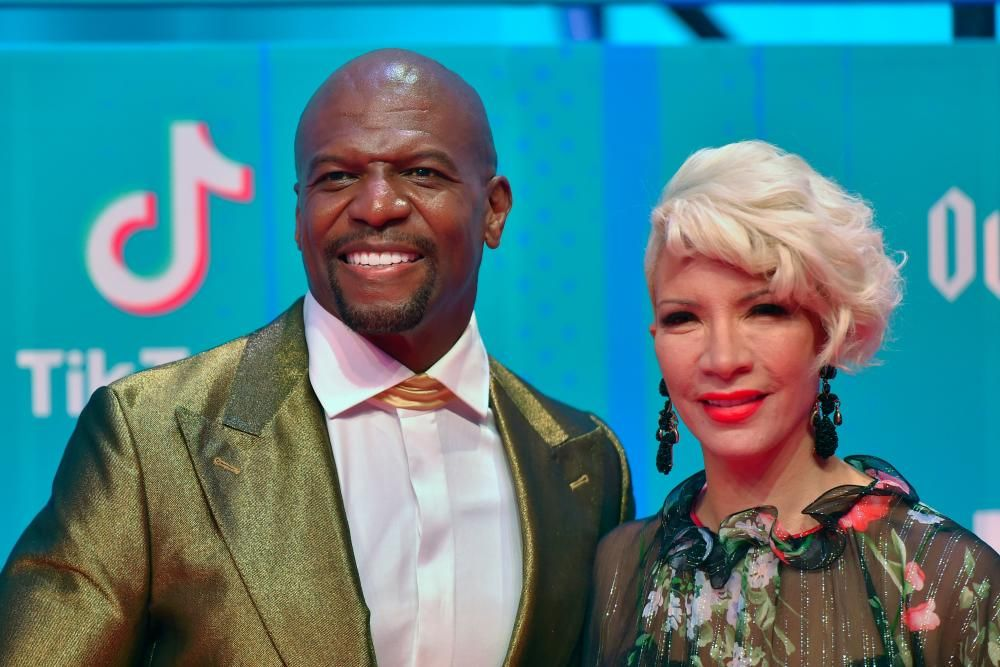 US actor Terry Crews and his wife Rebecca King-Crews pose on the red carpet ahead of the MTV Europe Music Awards at the Bizkaia Arena in the northern Spanish city of Bilbao on November 4, 2018. (Photo by ANDER GILLENEA / AFP)