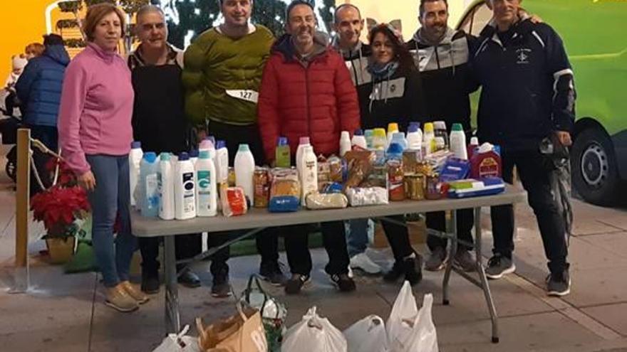 El Real de Gandia Cien kilos de alimentos en la San Silvestre solidaria