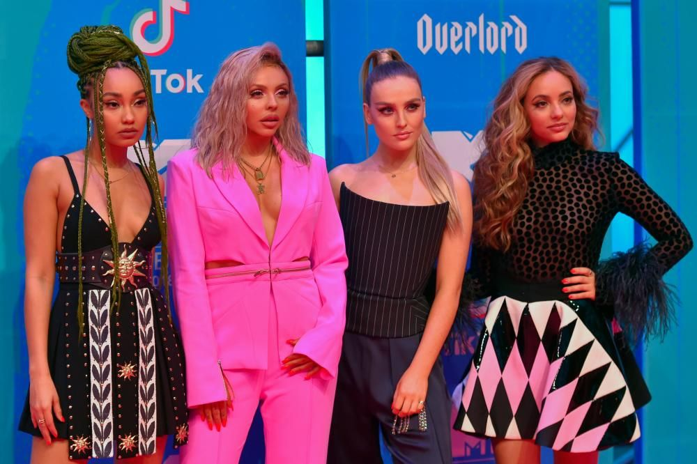 British group Little Mix pose on the red carpet ahead of the MTV Europe Music Awards at the Bizkaia Arena in the northern Spanish city of Bilbao on November 4, 2018. (Photo by ANDER GILLENEA / AFP)