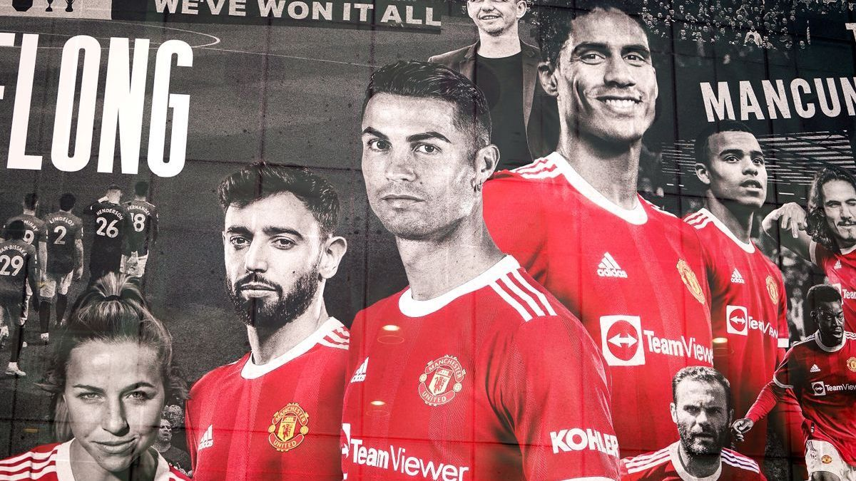 Poster at Old Trafford with Cristiano and Varane featured.