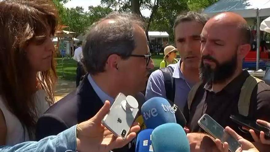 Torra deja un acto molesto con el embajador español