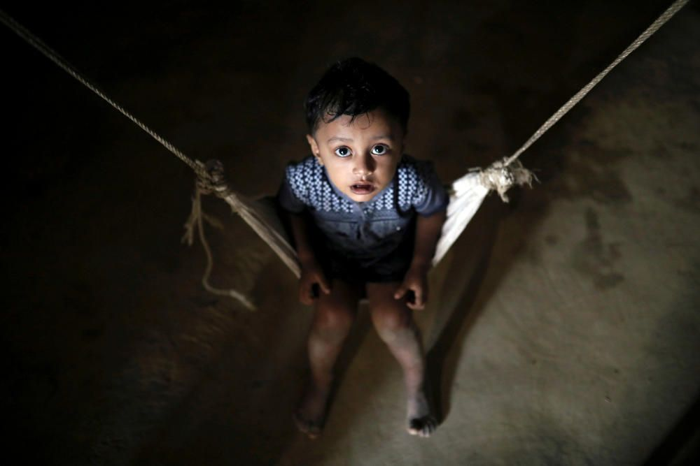A Rohingya refugee child reacts to the camera ...