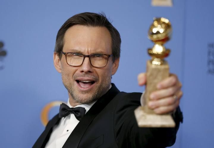 "Christian Slater poses backstage with the award for Best Performance by an Actor in a Supporting Role in a Series, Limited Series or Motion Picture Made for Television for his role in ""Mr. Robot"" at the 73rd Golden Globe Awards in Beverly Hills"