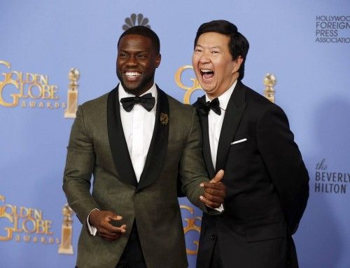 Kevin Hart and Ken Jeong pose backstage after presenting an award during the 73rd Golden Globe Awards in Beverly Hills