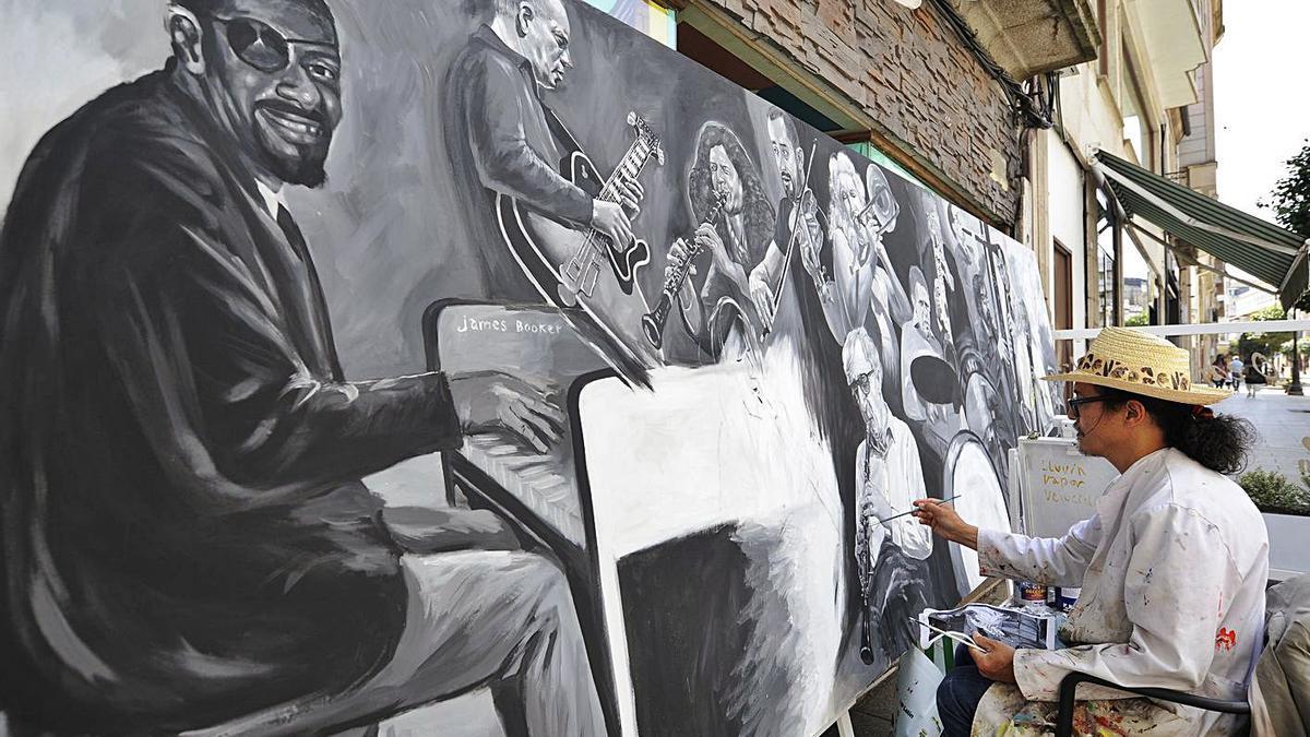 Carlos Santos pinta su cuadro de grandes dimensiones, ayer, en la calle Principal de Lalín.     // BERNABÉ/J. LALÍN