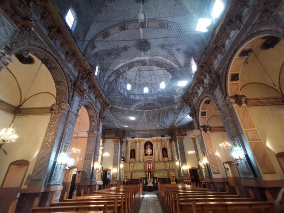 La Iglesia de Tuéjar cumple 10 años con mallas protectoras por peligro de derrumbes