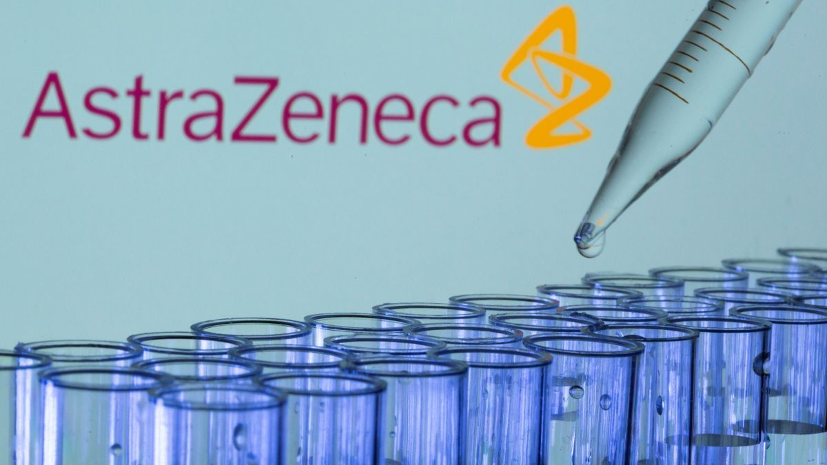 FILE PHOTO: Test tubes are seen in front of a displayed AstraZeneca logo in this illustration