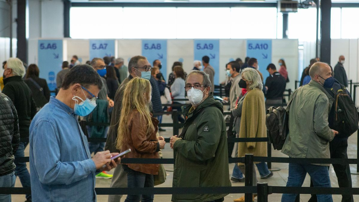 Several people wait their turn to get vaccinated in Barcelona.