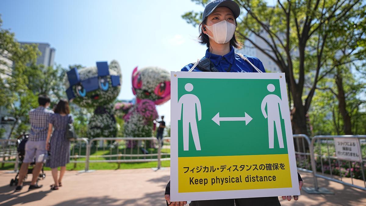 Senyals per prendre consciència del coronavirus als Jocs Olímpics de Tòquio.