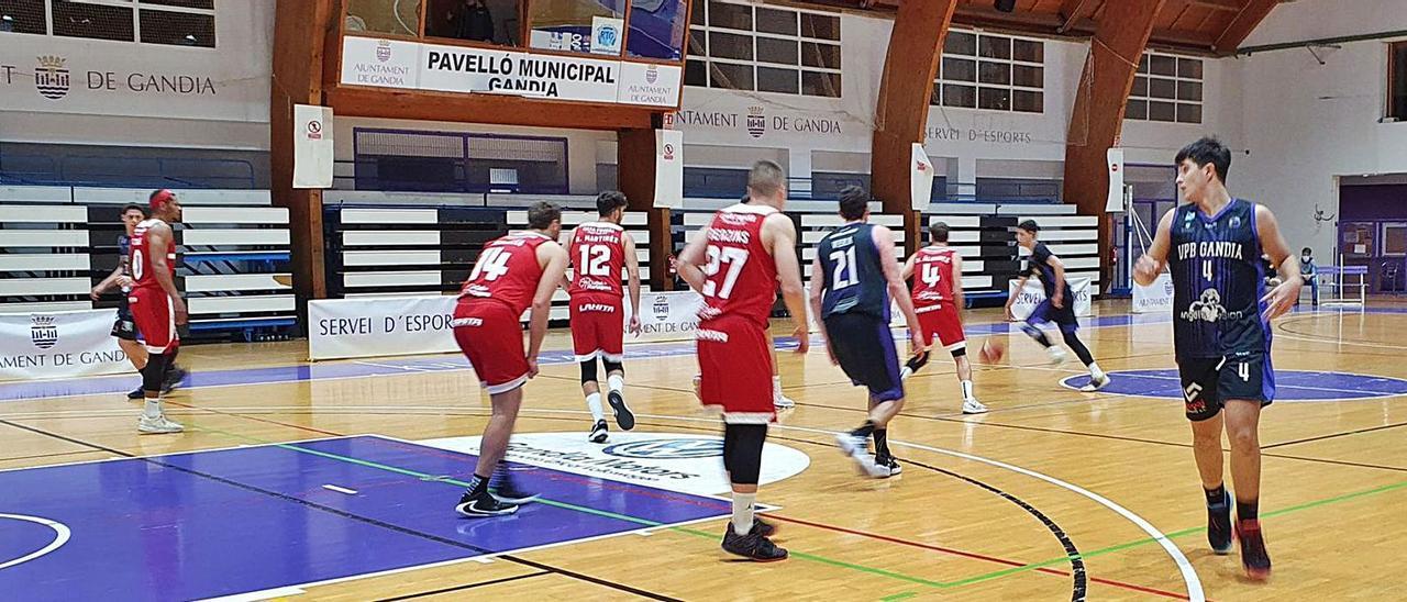 Un momento del partido que anoche disputaron el Angels Vision y el CF Cartagena en el pabellón municipal gandiense. | LEVANTE-EMV