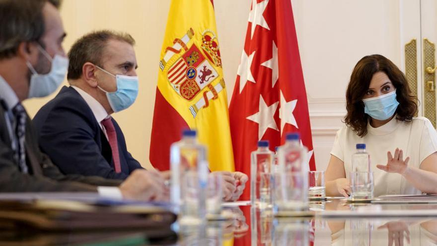 Ayuso pide 759 policías y guardias civiles para vigilar el estado de alarma en Madrid