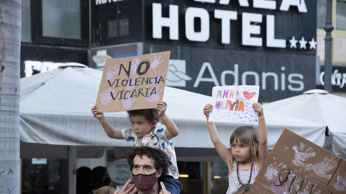 Two children with posters participate in a feminist rally.