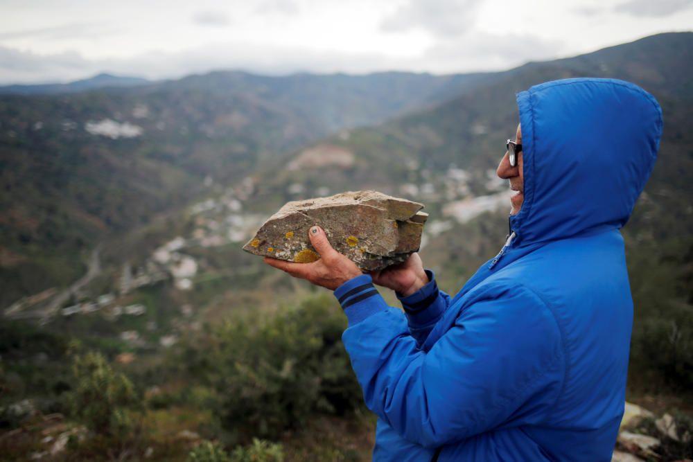 "Carlos Sanz, 74, shows a ""Pizarra"" stone, which ..."
