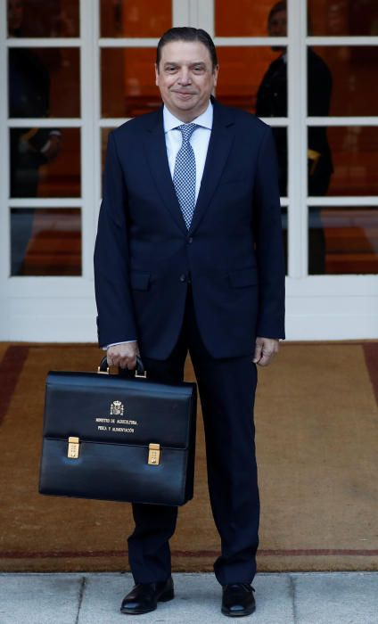 Spain's Prime Minister Pedro Sanchez holds his ...