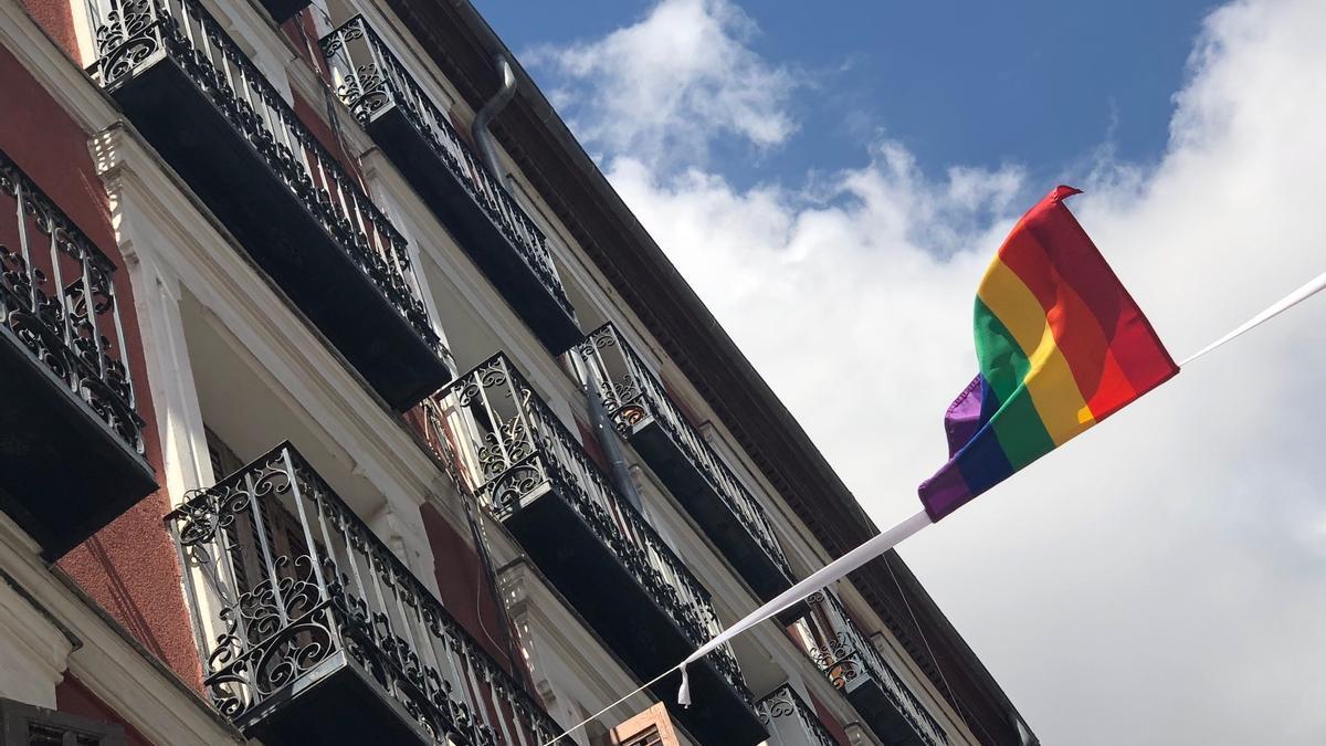 A rainbow flag in a window in Madrid