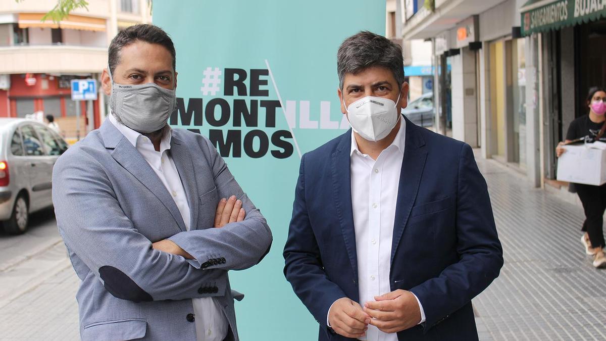 Manuel Carmona y Rafael Llamas, ante el logotipo del Plan #Remontamos.