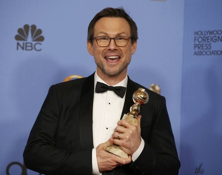 "Christian Slater poses with the award for Best Performance by an Actor in a Supporting Role in a Series, Limited Series or Motion Picture Made for Television for his role in ""Mr. Robot"" backstage at the 73rd Golden Globe Awards in Beverly Hills"