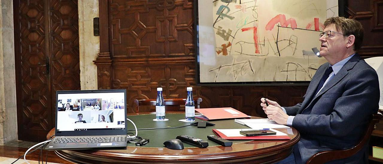 Ximo Puig durante la reunión telemática.