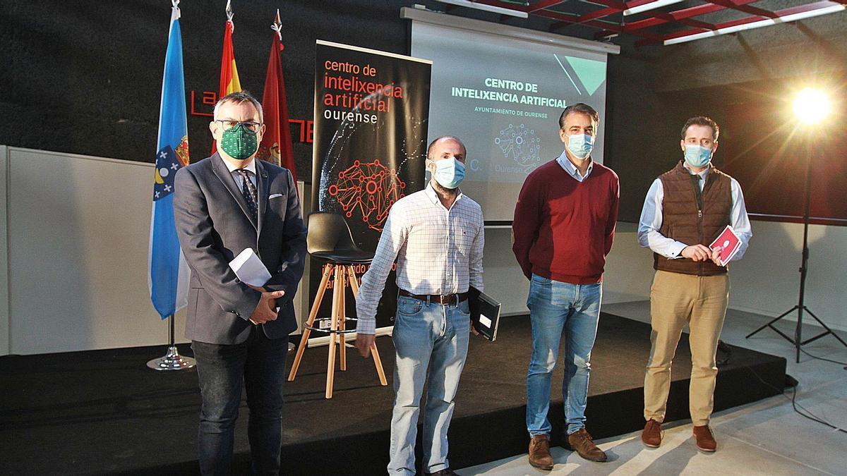 Jesús M. García, director UNED-Ourense; Jácome; Olivieri, director del centro de IA y Luis Babarro, presidente de AJE . |   // IÑAKI OSORIO
