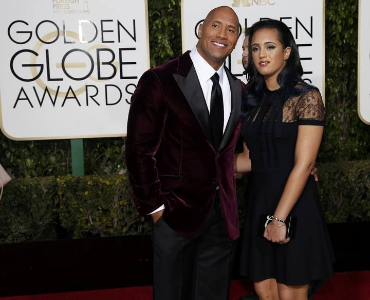 Dwayne Johnson and a guest arrive at the 73rd Golden Globe Awards in Beverly Hills