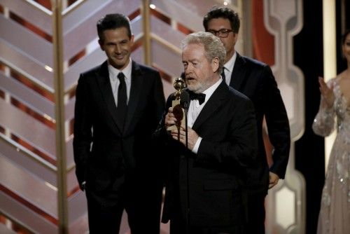 "Scott accepts the award after ""The Martian"" won Best Motion Picture - Comedy at the 73rd Golden Globe Awards in Beverly Hills"