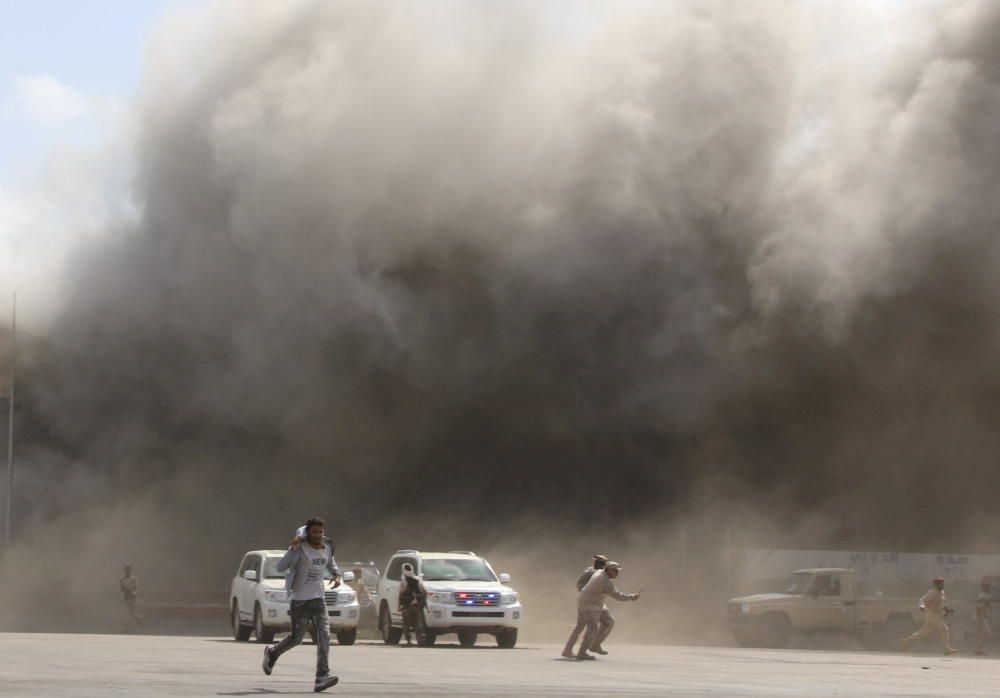 People react as dust rises after explosions hit ...