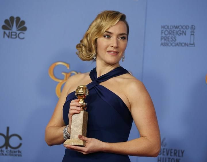 "Actress Kate Winslet poses with her award for Best Performance by an Actress in a Supporting Role in any Motion Picture for her role in ""Steve Jobs"" backstage at the 73rd Golden Globe Awards in Beverly Hills"