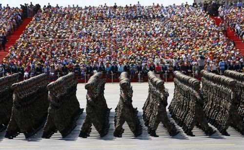 Soldiers of China's People's Liberation Army march during the military parade to mark the 70th anniversary of the end of World War Two, in Beijing