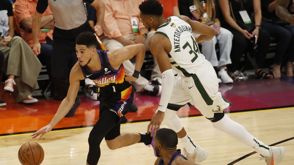 Booker escapes from Antetokounmpo's marking.