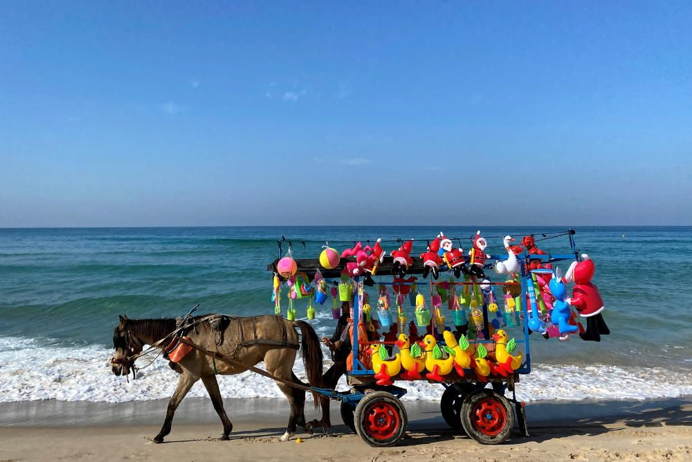 Palestinian vendor sells toys at Gaza beach