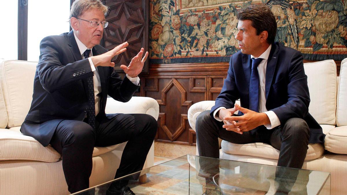 Ximo Puig y Carlos Mazón, en una reunión mantenida hace justo un año.
