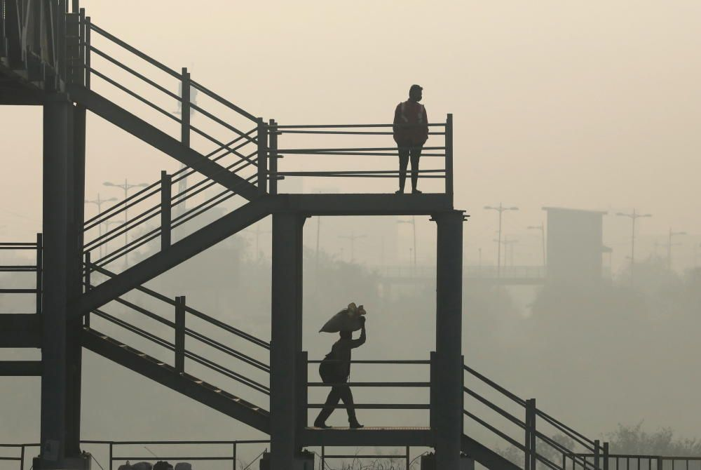 Men are seen on a skywalk near Delhi-Meerut ...