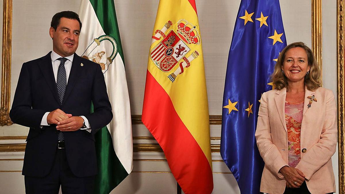 El presidente andaluz recibió ayer en San Telmo a la vicepresidenta Nadia Calviño