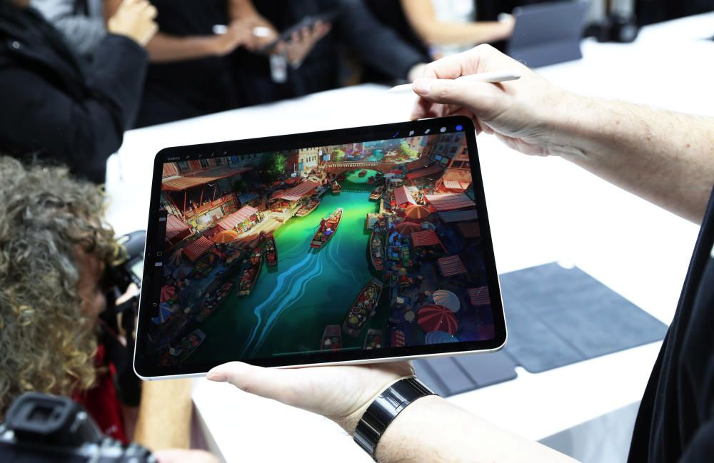 Attendees try out the new iPad Pro during an ...