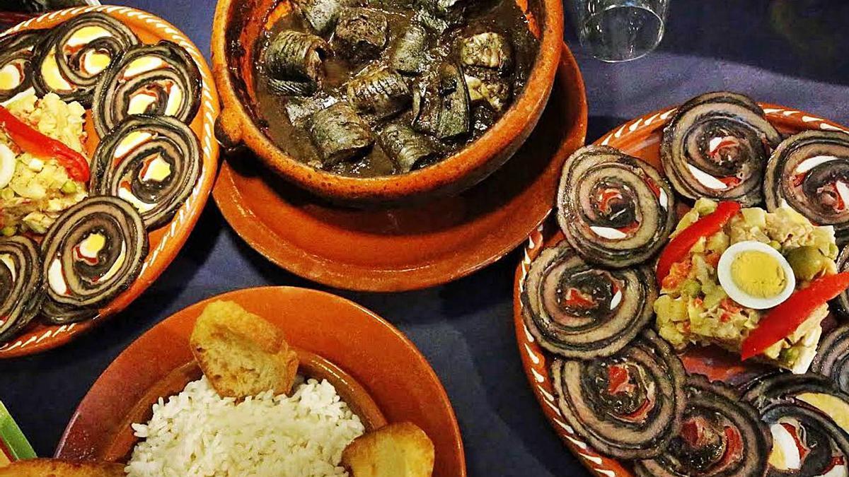 Lamprea ao estilo Arbo, con arroz e pan, e lamprea rechea con salpicón.     // D.P.