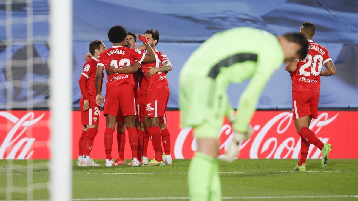 Sevilla players celebrate celebrating a goal against Real Madrid.