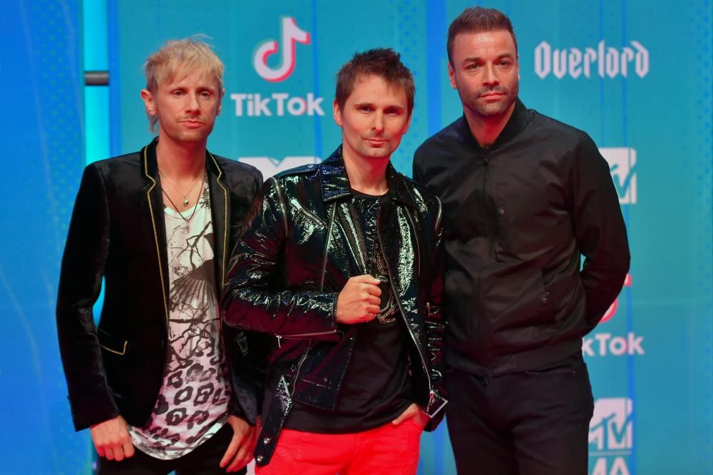 English band Muse pose on the red carpet ahead of the MTV Europe Music Awards at the Bizkaia Arena in the northern Spanish city of Bilbao on November 4, 2018. (Photo by ANDER GILLENEA / AFP)