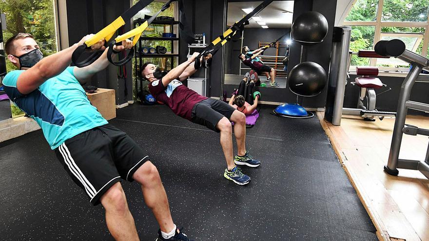 Los gimnasios sacan músculo y encaran la crisis