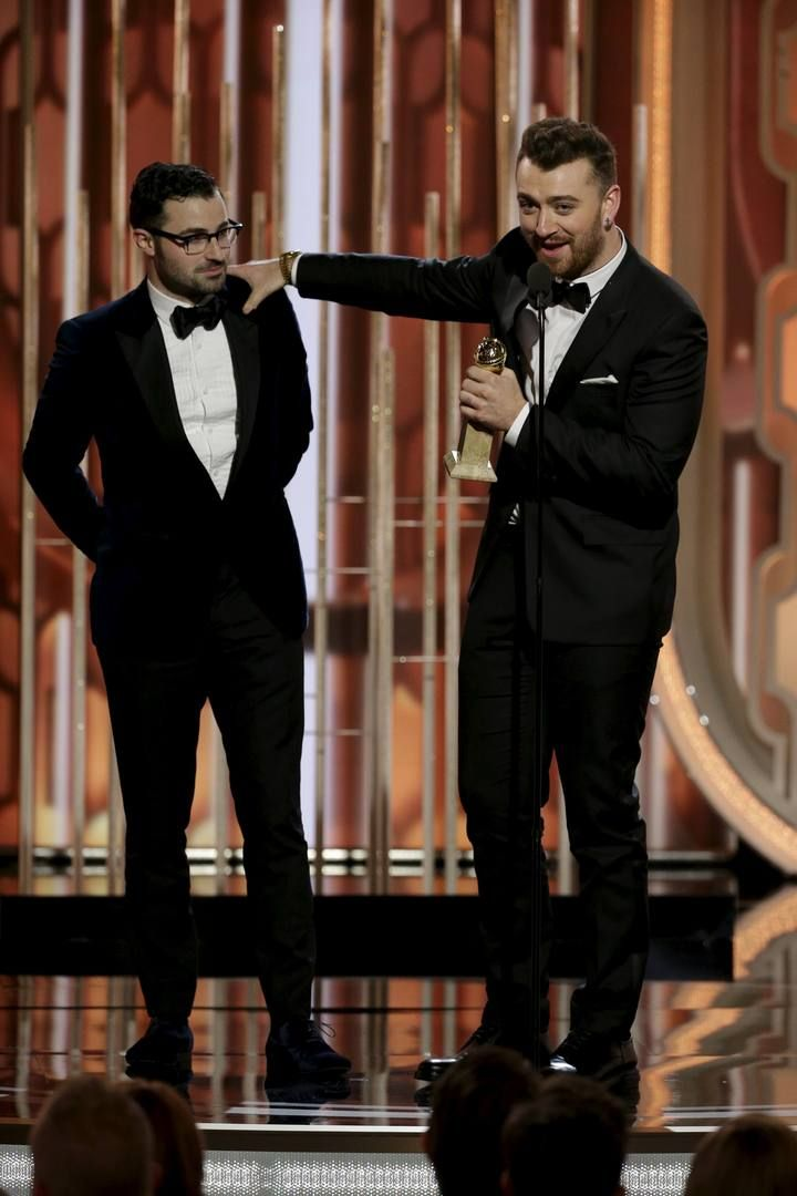 "Handout photo of Sam Smith accepting the award for Best Original Song, Motion Picture, for ""Writing's on the Wall"" at the 73rd Golden Globe Awards in Beverly Hills"