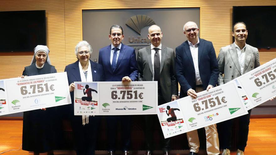 """Unicaja y El Corte Inglés entregan los cheques de la Carrera """"Ciudad de Málaga"""""""