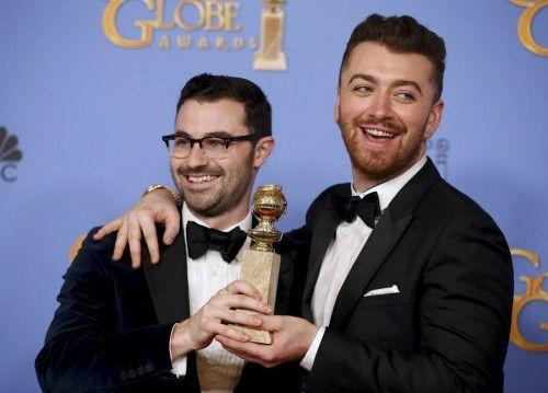 Sam Smith and Jimmy Napes pose with their award during the 73rd Golden Globe Awards in Beverly Hills