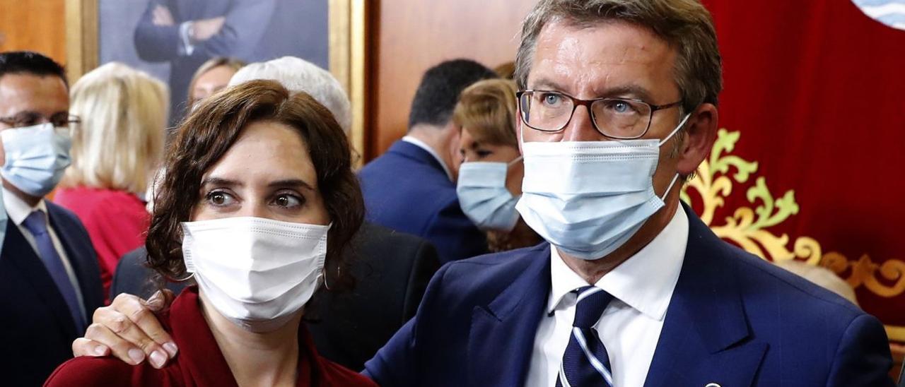 Isabel Díaz Ayuso y Alberto Núñez Feijóo, en la toma de posesión del segundo.
