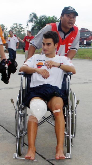 Honda MotoGP rider Pedrosa of Spain is pushed on ...