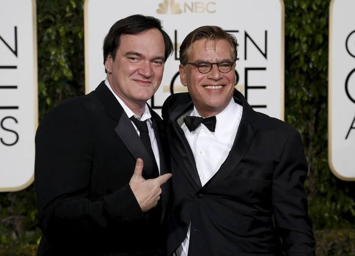 Director Tarantino and screenwriter Sorkin pose together as they arrive at the 73rd Golden Globe Awards in Beverly Hills