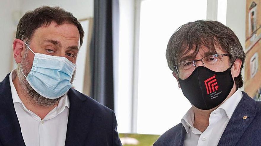 Oriol Junqueras i Carles Puigdemont | ARXIU/STEPHANIE LECOCQ/EFE