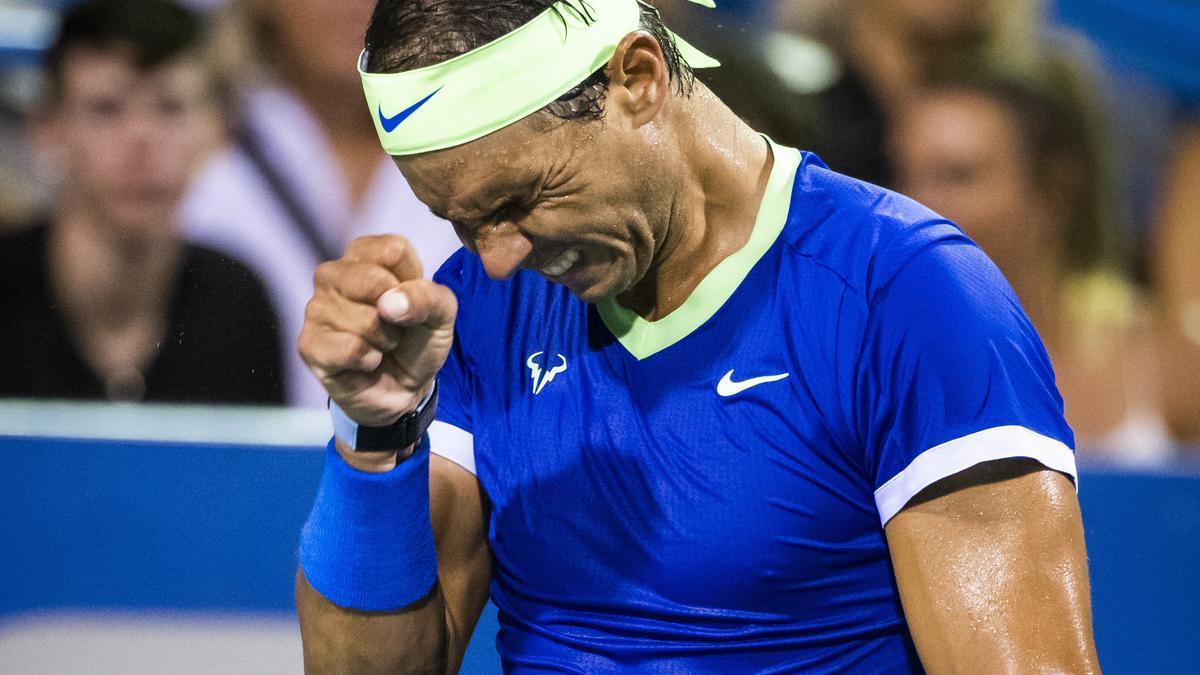 Rafael Nadal makes a gesture of pain.
