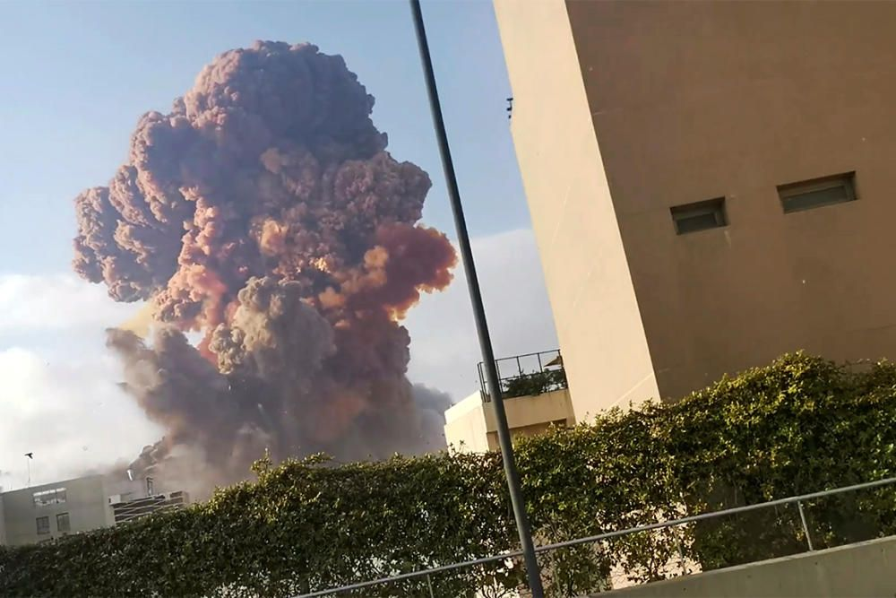 Smoke rises after an explosion in Beirut